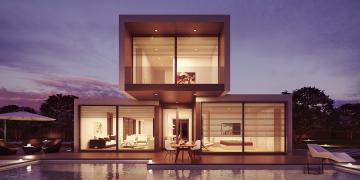 Modern luxury home with big windows and fancy lighting